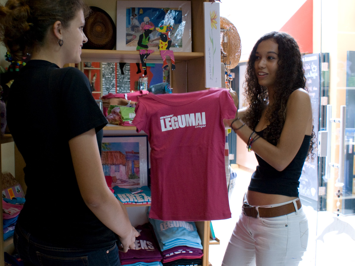 buying a pink shirt in a shop
