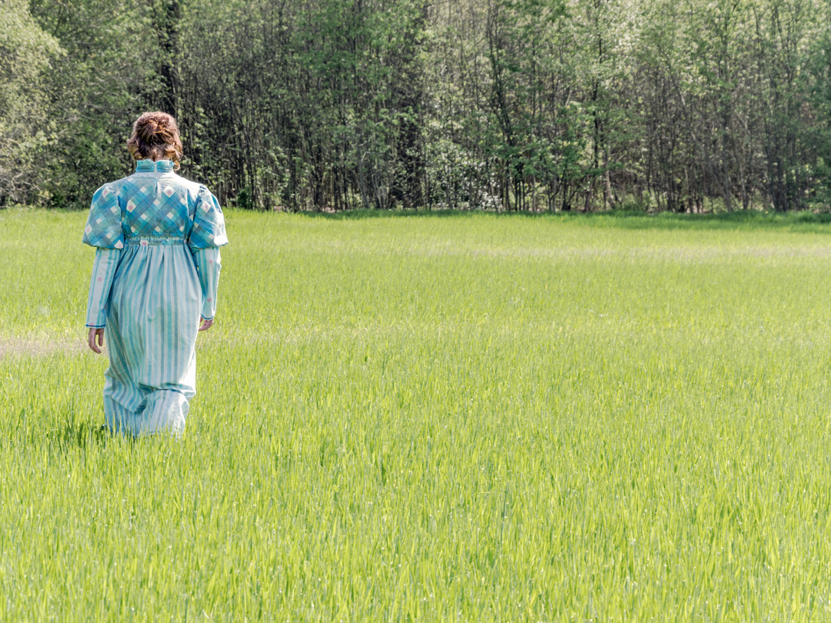 Mireille showing the handmade dress - walking a meadow