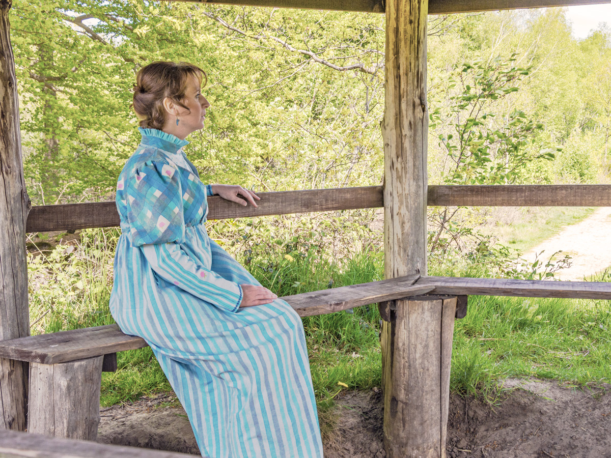 Mireille showing the handmade dress - sitting tea