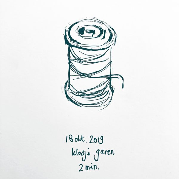 drawing spool of thread