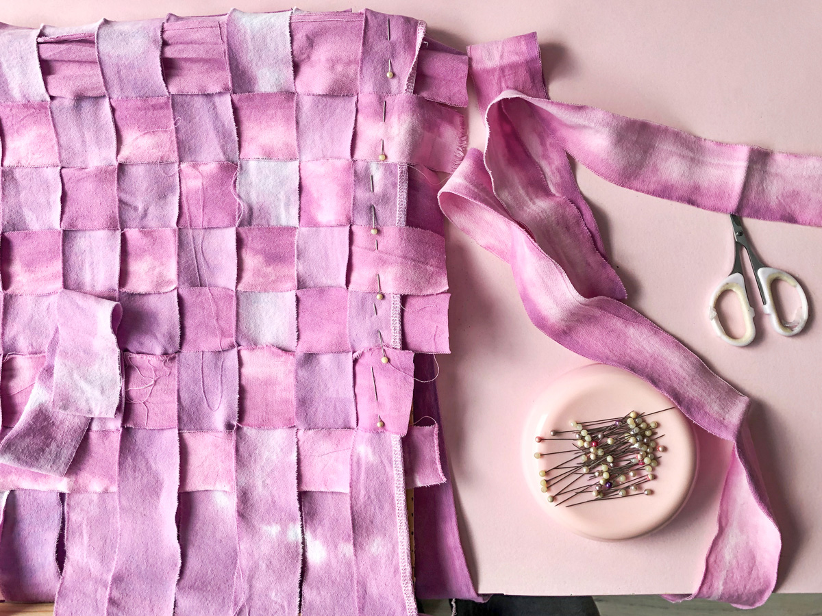 Fabric weaving with sewing pins