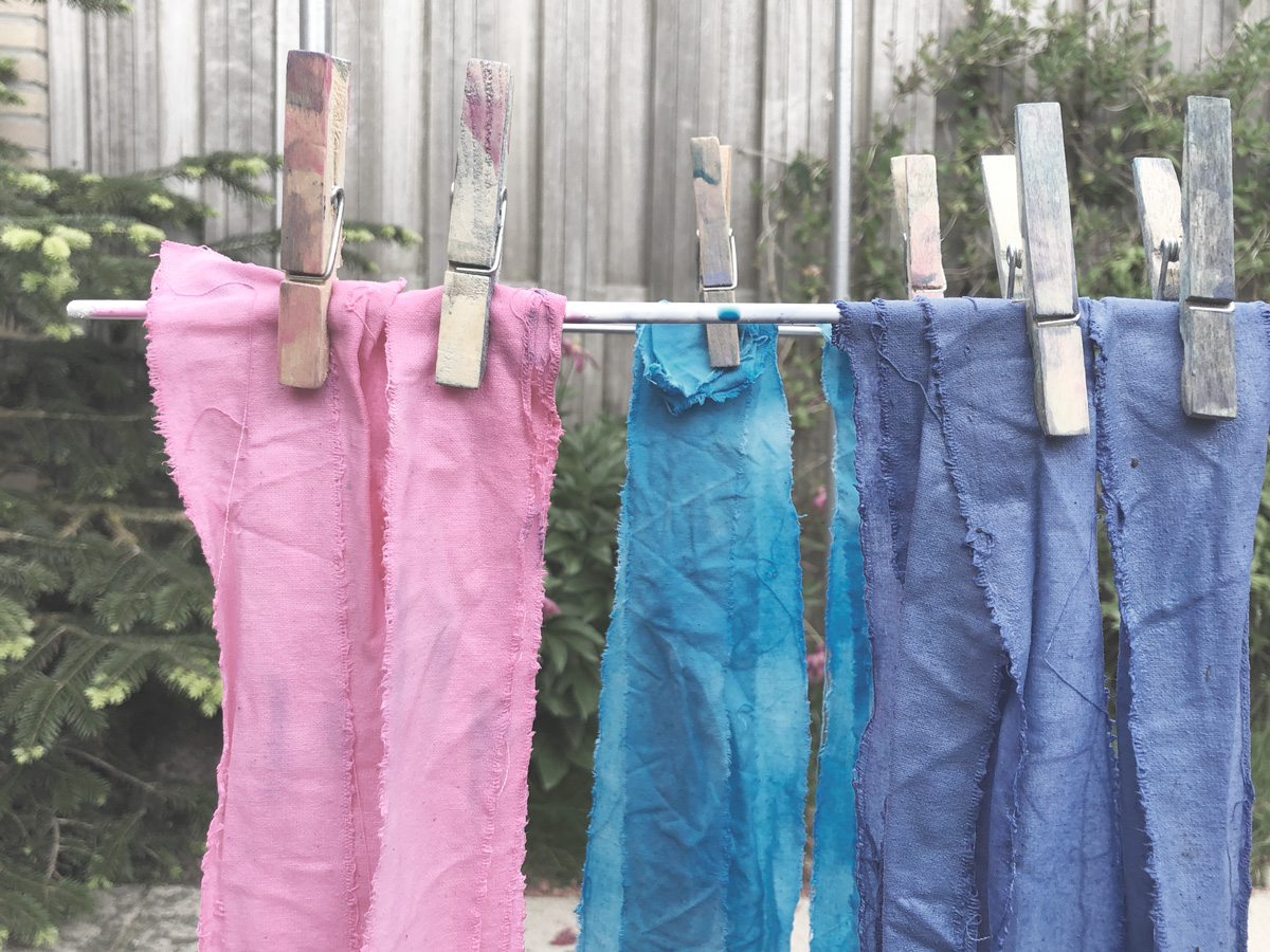 Dyed fabric strips hanging