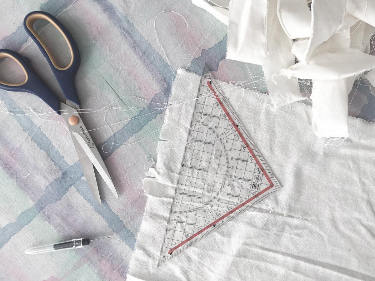 fabric, ruler and scissors