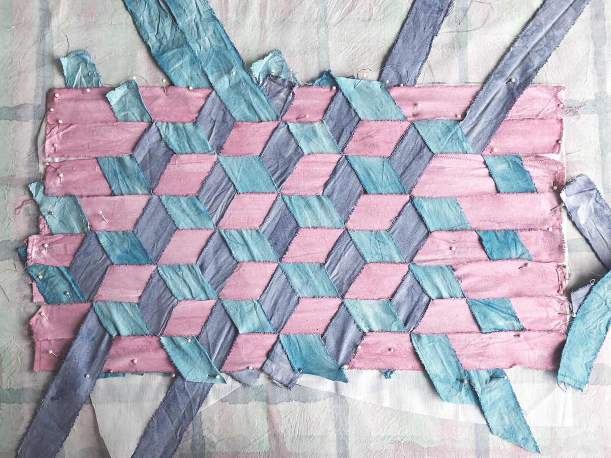 Triaxial weaving with sewing pins