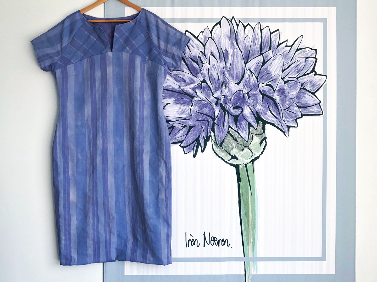 Dress hanging in front of a cornflower drawing
