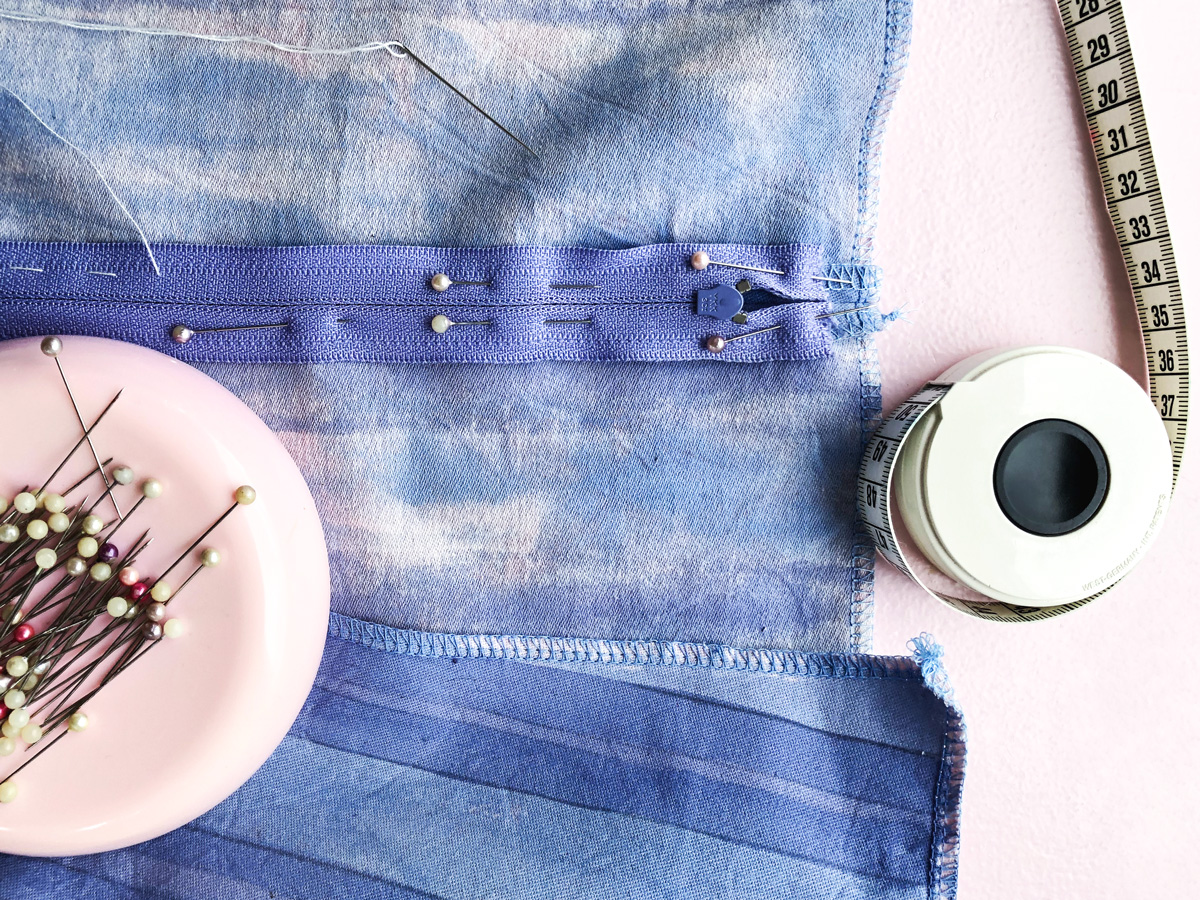 sewing pins, zipper and tape measure
